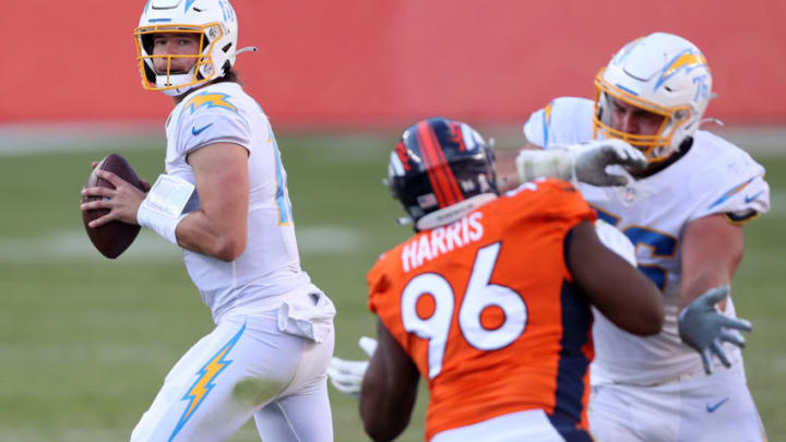 DENVER, COLORADO - NOVEMBER 01: Quarterback Justin Herbert #10 of the Los Angeles Chargers looks to pass against Shelby Harris #96 of the Denver Broncos in the second quarter of the game at Empower Field At Mile High on November 01, 2020 in Denver, Colorado. (Photo by Matthew Stockman/Getty Images)