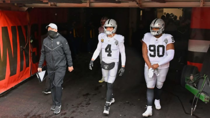 CLEVELAND, OH - NOVEMBER 1: Derek Carr #4 of the Las Vegas Raiders and Johnathan Hankins #90 of the Las Vegas Raiders take the field before a game against the Cleveland Browns at FirstEnergy Stadium on November 1, 2020 in Cleveland, Ohio. (Photo by Jamie Sabau/Getty Images)