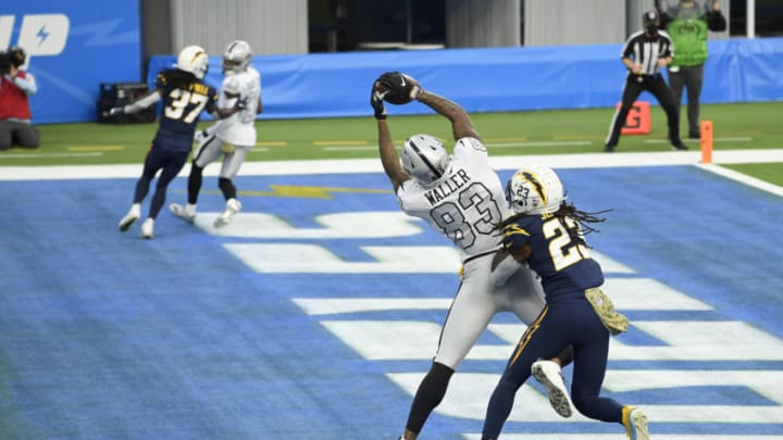 INGLEWOOD, CALIFORNIA - NOVEMBER 08: Darren Waller #83 of the Las Vegas Raiders catches a third quarter touchdown in front of Rayshawn Jenkins #23 of the Los Angeles Chargers at SoFi Stadium on November 08, 2020 in Inglewood, California. (Photo by Harry How/Getty Images)