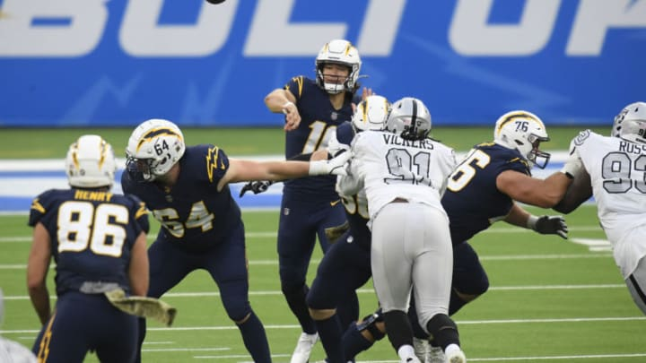 INGLEWOOD, CALIFORNIA - NOVEMBER 08: Justin Herbert #10 of the Los Angeles Chargers throws a fourth quarter pass against the Las Vegas Raiders at SoFi Stadium on November 08, 2020 in Inglewood, California. (Photo by Harry How/Getty Images)