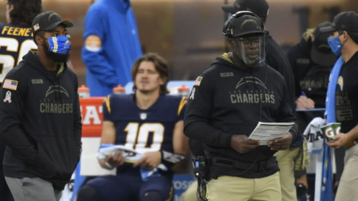 INGLEWOOD, CALIFORNIA - NOVEMBER 08: Head coach of the Los Angeles Chargers looks on in front of Justin Herbert #10 while playing the Las Vegas Raiders at SoFi Stadium on November 08, 2020 in Inglewood, California. (Photo by Harry How/Getty Images)