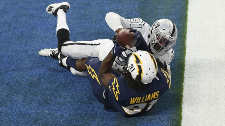 INGLEWOOD, CALIFORNIA - NOVEMBER 08: Mike Williams #81 of the Los Angeles Chargers can't hold on to a fourth quarter touchdown catch against Isaiah Johnson #31 of the Las Vegas Raiders at SoFi Stadium on November 08, 2020 in Inglewood, California. (Photo by Harry How/Getty Images)