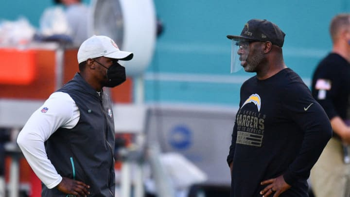 MIAMI GARDENS, FLORIDA - NOVEMBER 15: Head coach Brian Flores of the Miami Dolphins and head coach Anthony Lynn of the Los Angeles Chargers speak prior to the game at Hard Rock Stadium on November 15, 2020 in Miami Gardens, Florida. (Photo by Mark Brown/Getty Images)