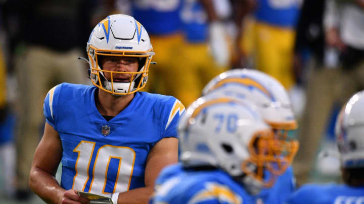 MIAMI GARDENS, FLORIDA - NOVEMBER 15: Justin Herbert #10 of the Los Angeles Chargers heads to the huddle against the Miami Dolphins at Hard Rock Stadium on November 15, 2020 in Miami Gardens, Florida. (Photo by Mark Brown/Getty Images)