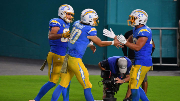 MIAMI GARDENS, FLORIDA - NOVEMBER 15: Justin Herbert #10 of the Los Angeles Chargers celebrates a touchdown against the Miami Dolphins at Hard Rock Stadium on November 15, 2020 in Miami Gardens, Florida. (Photo by Mark Brown/Getty Images)