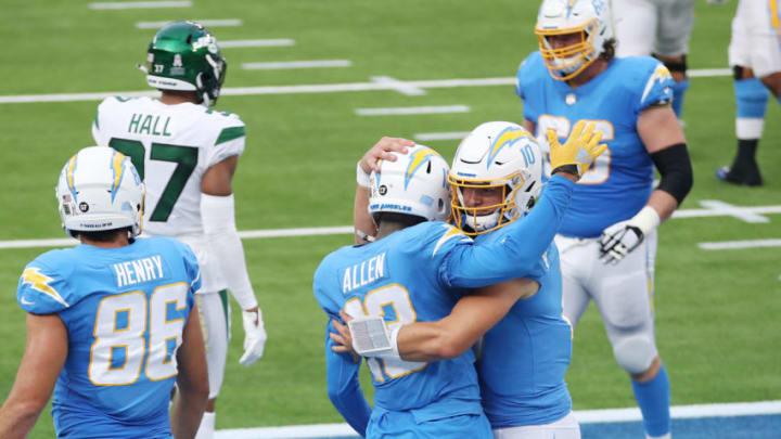 INGLEWOOD, CALIFORNIA - NOVEMBER 22: Justin Herbert #10 celebrates a touchdown with Keenan Allen #13 of the Los Angeles Chargers during the first half against the New York Jets at SoFi Stadium on November 22, 2020 in Inglewood, California. (Photo by Katelyn Mulcahy/Getty Images)