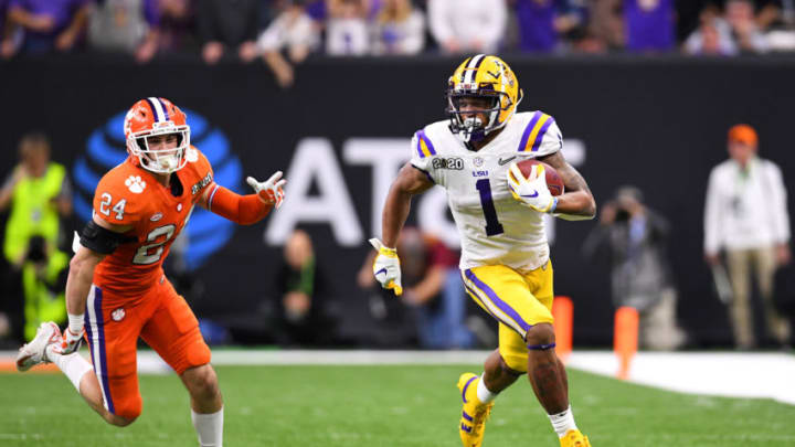 NEW ORLEANS, LA - JANUARY 13: Ja'Marr Chase #1 of the LSU Tigers races past Nolan Turner #24 of the Clemson Tigers during the College Football Playoff National Championship held at the Mercedes-Benz Superdome on January 13, 2020 in New Orleans, Louisiana. (Photo by Jamie Schwaberow/Getty Images)