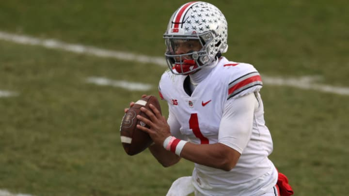 EAST LANSING, MICHIGAN - DECEMBER 05: Justin Fields #1 of the Ohio State Buckeyes looks to pass in the second half against the Michigan State Spartans at Spartan Stadium on December 05, 2020 in East Lansing, Michigan. Ohio State won the game 52-12. (Photo by Gregory Shamus/Getty Images)