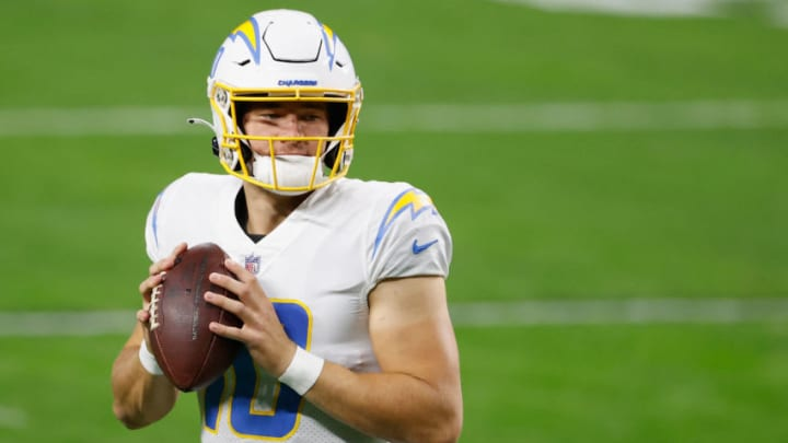 LAS VEGAS, NEVADA - DECEMBER 17: Quarterback Justin Herbert #10 of the Los Angeles Chargers warms up during the NFL game against the Las Vegas Raiders at Allegiant Stadium on December 17, 2020 in Las Vegas, Nevada. The Chargers defeated the Raiders in overtime 30-27. (Photo by Christian Petersen/Getty Images)