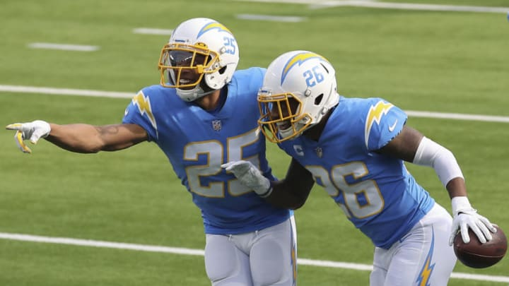 INGLEWOOD, CALIFORNIA - DECEMBER 27: Chris Harris #25 and Casey Hayward #26 of the Los Angeles Chargers celebrate an interception by Hayward during the first quarter against the Denver Broncos at SoFi Stadium on December 27, 2020 in Inglewood, California. (Photo by Sean M. Haffey/Getty Images)