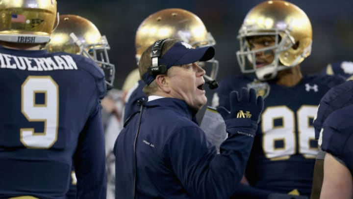 NASHVILLE, TN - DECEMBER 30: Brian Kelly the head coach of the Notre Dame Fighting Irish gives instructions to his team during the Franklin American Mortgage Music City Bowl against the LSU Tigers at LP Field on December 30, 2014 in Nashville, Tennessee. (Photo by Andy Lyons/Getty Images)
