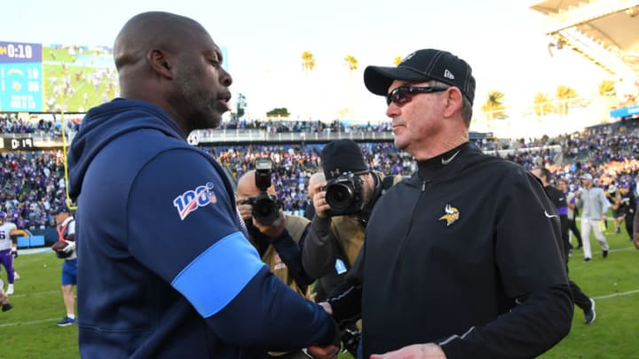 CARSON, CA - DECEMBER 15: Head coach Anthony Lynn of the Los Angeles Chargers and head coach Mike Zimmer of the Minnesota Vikings shake hands after the game at Dignity Health Sports Park on December 15, 2019 in Carson, California. (Photo by Jayne Kamin-Oncea/Getty Images)