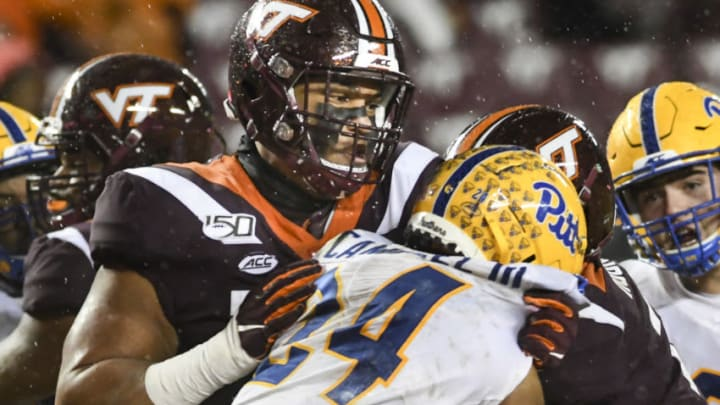 BLACKSBURG, VA - NOVEMBER 23: Offensive lineman Christian Darrisaw #77 of the Virginia Tech Hokies blocks linebacker Phil Campbell III #24 of the Pittsburgh Panthers in the second half at Lane Stadium on November 23, 2019 in Blacksburg, Virginia. (Photo by Michael Shroyer/Getty Images)
