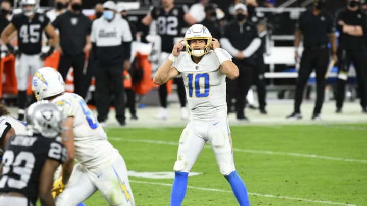 LAS VEGAS, NEVADA - DECEMBER 17: Quarterback Justin Herbert #10 of the Los Angeles Chargers calls a play at the line of scrimmage in the second half of their game against the Las Vegas Raiders at Allegiant Stadium on December 17, 2020 in Las Vegas, Nevada. (Photo by Chris Unger/Getty Images)