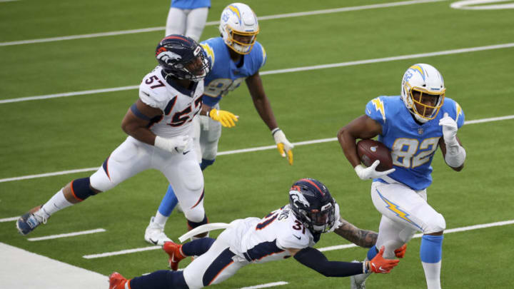 INGLEWOOD, CALIFORNIA - DECEMBER 27: Stephen Anderson #82 of the Los Angeles Chargers carries the ball past Justin Simmons #31 of the Denver Broncos at SoFi Stadium on December 27, 2020 in Inglewood, California. (Photo by Sean M. Haffey/Getty Images)