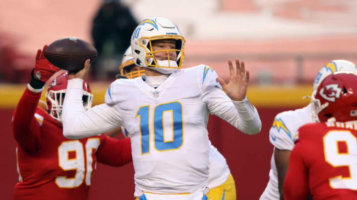 KANSAS CITY, MISSOURI - JANUARY 03: Quarterback Justin Herbert #10 of the Los Angeles Chargers passes during the game against the Kansas City Chiefs at Arrowhead Stadium on January 03, 2021 in Kansas City, Missouri. (Photo by Jamie Squire/Getty Images)