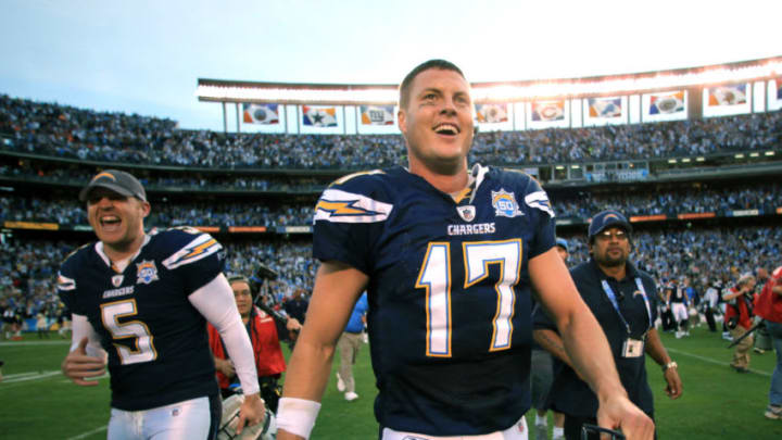 SAN DIEGO, CA - DECEMBER 20: Quarterback Philip Rivers #17 and punter Mike Scifres #5 of the San Diego Chargers walk off the field after the Chargers 27-24 win against the Cincinnati Bengals during the NFL game on December 20, 2009 at Qualcomm Stadium in San Diego, California. (Photo by Donald Miralle/Getty Images)