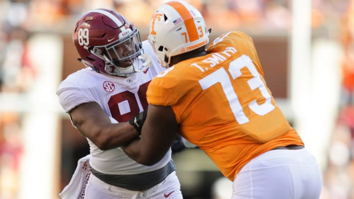 LaBryan Ray #89 of the Alabama Crimson Tide battles with Offensive lineman Trey Smith #73 of the Tennessee Volunteers (Photo by Donald Page/Getty Images)