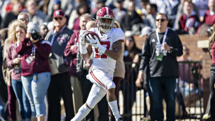 FAYETTEVILLE, AR - NOVEMBER 9: Jaylen Waddle #17 of the Alabama Crimson Tide catches a pass for a touchdown during a game against the Mississippi State Bulldogs at Davis Wade Stadium on November 16, 2019 in Starkville, Mississippi. The Crimson Tide defeated the Bulldogs 38-7. (Photo by Wesley Hitt/Getty Images)