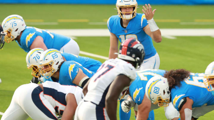 INGLEWOOD, CALIFORNIA - DECEMBER 27: Justin Herbert #10 of the Los Angeles Chargers makes a play call from the back field in the first quarter against the Denver Broncos at SoFi Stadium on December 27, 2020 in Inglewood, California. (Photo by Joe Scarnici/Getty Images)