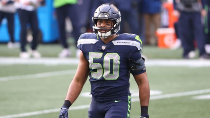SEATTLE, WASHINGTON - JANUARY 09: K.J. Wright #50 of the Seattle Seahawks looks on in the first quarter against the Los Angeles Rams during the NFC Wild Card Playoff game at Lumen Field on January 09, 2021 in Seattle, Washington. (Photo by Abbie Parr/Getty Images)