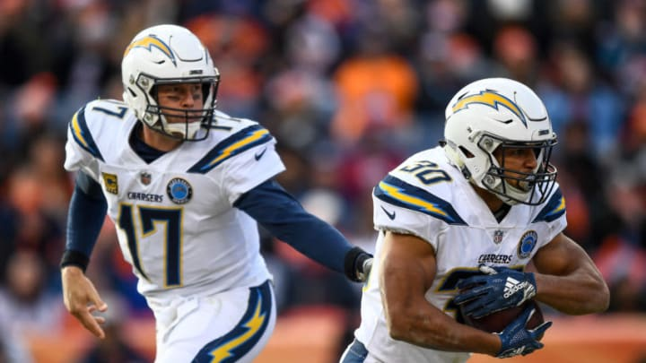 DENVER, CO - DECEMBER 30: Quarterback Philip Rivers #17 of the Los Angeles Chargers hands the ball to running back Austin Ekeler #30 in the first half of a game against the Denver Broncos at Broncos Stadium at Mile High on December 30, 2018 in Denver, Colorado. (Photo by Dustin Bradford/Getty Images)