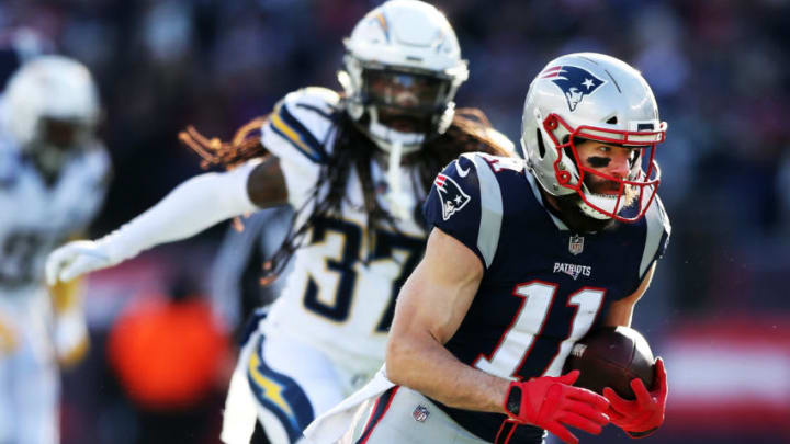 FOXBOROUGH, MASSACHUSETTS - JANUARY 13: Julian Edelman #11 of the New England Patriots runs the ball during the second quarter in the AFC Divisional Playoff Game against the Los Angeles Chargers at Gillette Stadium on January 13, 2019 in Foxborough, Massachusetts. (Photo by Adam Glanzman/Getty Images)