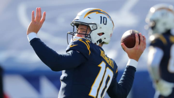 ORCHARD PARK, NY - NOVEMBER 29: Justin Herbert #10 of the Los Angeles Chargers throws a pass before a game against the Buffalo Bills at Bills Stadium on November 29, 2020 in Orchard Park, New York. (Photo by Timothy T Ludwig/Getty Images)