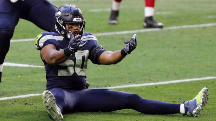 GLENDALE, ARIZONA - JANUARY 03: Linebacker K.J. Wright #50 of the Seattle Seahawks reacts after a tackle during the second quarter against the San Francisco 49ers at State Farm Stadium on January 03, 2021 in Glendale, Arizona. (Photo by Chris Coduto/Getty Images)