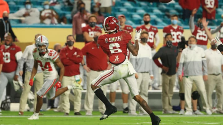 MIAMI GARDENS, FLORIDA - JANUARY 11: DeVonta Smith #6 of the Alabama Crimson Tide makes a reception for a 42 yard touchdown during the second quarter of the College Football Playoff National Championship game against the Ohio State Buckeyes at Hard Rock Stadium on January 11, 2021 in Miami Gardens, Florida. (Photo by Mike Ehrmann/Getty Images)