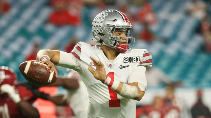 MIAMI GARDENS, FLORIDA - JANUARY 11: Justin Fields #1 of the Ohio State Buckeyes looks to pass during the third quarter of the College Football Playoff National Championship game against the Alabama Crimson Tide at Hard Rock Stadium on January 11, 2021 in Miami Gardens, Florida. (Photo by Mike Ehrmann/Getty Images)