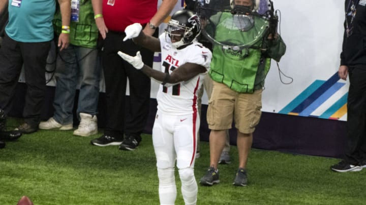 MINNEAPOLIS, MN - OCTOBER 18: Julio Jones #11 of the Atlanta Falcons celebrates after scoring a touchdown in the first quarter of the game against the Minnesota Vikings at U.S. Bank Stadium on October 18, 2020 in Minneapolis, Minnesota. (Photo by Stephen Maturen/Getty Images)
