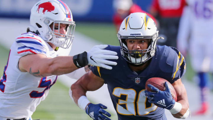 ORCHARD PARK, NEW YORK - NOVEMBER 29: A.J. Klein #54 of the Buffalo Bills attempts to tackle Austin Ekeler #30 of the Los Angeles Chargers during the first quarter at Bills Stadium on November 29, 2020 in Orchard Park, New York. (Photo by Timothy T Ludwig/Getty Images)