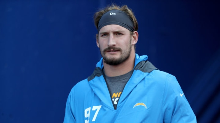 ORCHARD PARK, NEW YORK - NOVEMBER 29: Joey Bosa #97 of the Los Angeles Chargers walks to the field prior to a game against the Buffalo Bills at Bills Stadium on November 29, 2020 in Orchard Park, New York. (Photo by Bryan Bennett/Getty Images)
