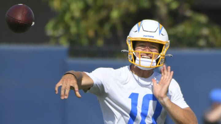 COSTA MESA, CA - JUNE 16: Justin Herbert #10 of the Los Angeles Chargers throws the ball during mandatory minicamp at the Hoag Performance Center on June 16, 2021 in Costa Mesa, California. (Photo by John McCoy/Getty Images)