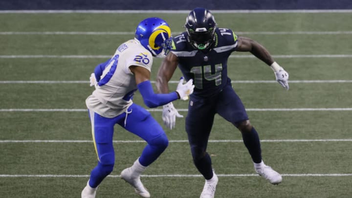 SEATTLE, WASHINGTON - JANUARY 09: Cornerback Jalen Ramsey #20 of the Los Angeles Rams covers wide receiver DK Metcalf #14 of the Seattle Seahawks during the NFC Wild Card Playoff game at Lumen Field on January 09, 2021 in Seattle, Washington. (Photo by Steph Chambers/Getty Images)