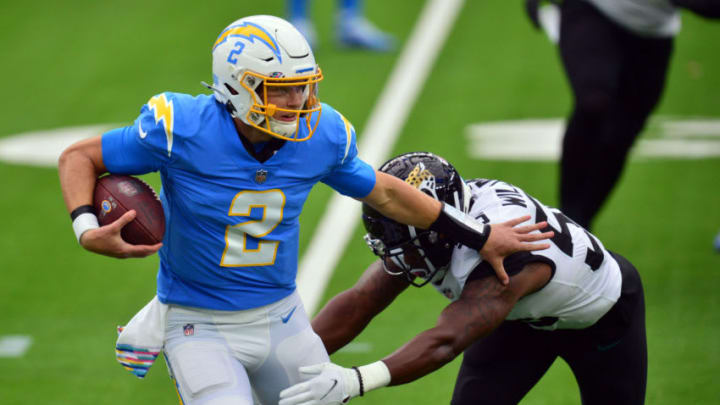 Oct 25, 2020; Inglewood, California, USA; Los Angeles Chargers quarterback Easton Stick (2) runs the ball against the Jacksonville Jaguars during the first half at SoFi Stadium. Mandatory Credit: Gary A. Vasquez-USA TODAY Sports