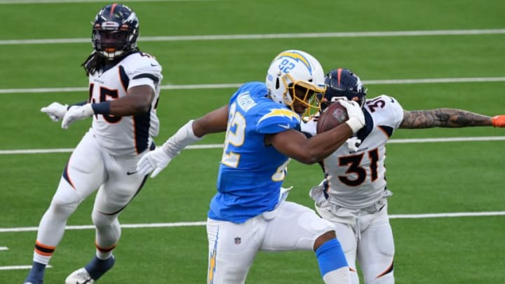 Dec 27, 2020; Inglewood, California, USA; Los Angeles Chargers tight end Stephen Anderson (82) runs along the sideline while defended by Denver Broncos free safety Justin Simmons (31) in the third quarter at SoFi Stadium. Mandatory Credit: Robert Hanashiro-USA TODAY Sports