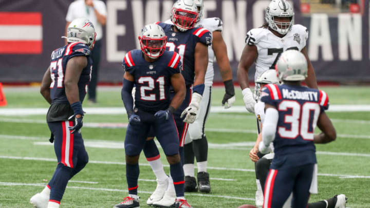 Sep 27, 2020; Foxborough, Massachusetts, USA; New England Patriots cornerback Adrian Phillips (21) reacts during the first half against the Las Vegas Raiders at Gillette Stadium. Mandatory Credit: Paul Rutherford-USA TODAY Sports