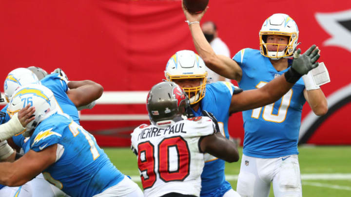 Oct 4, 2020; Tampa, Florida, USA; Los Angeles Chargers quarterback Justin Herbert (10) throws a pass against the Tampa Bay Buccaneers in the fourth quarter of a NFL game at Raymond James Stadium. Mandatory Credit: Kim Klement-USA TODAY Sports
