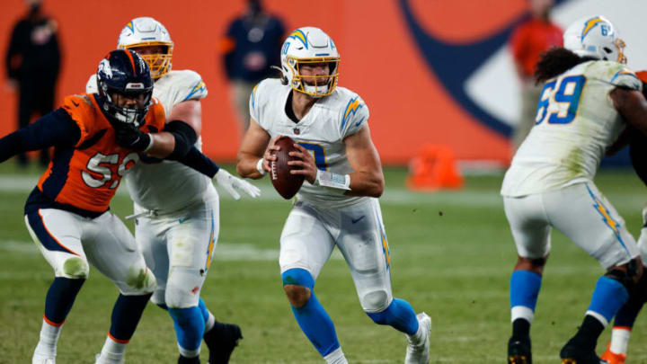 Nov 1, 2020; Denver, Colorado, USA; Los Angeles Chargers quarterback Justin Herbert (10) scrambles with the ball in the fourth quarter against the Denver Broncos at Empower Field at Mile High. Mandatory Credit: Isaiah J. Downing-USA TODAY Sports