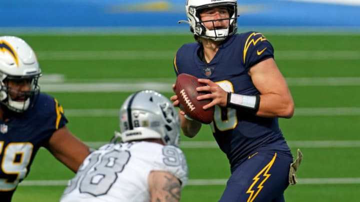 Nov 8, 2020; Inglewood, California, USA; Los Angeles Chargers quarterback Justin Herbert (10) drops back to pass against the against the Las Vegas Raiders during the first half at SoFi Stadium. Mandatory Credit: Kirby Lee-USA TODAY Sports
