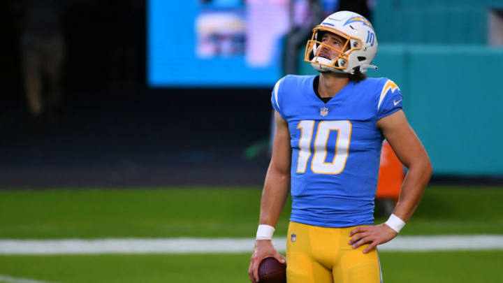Nov 15, 2020; Miami Gardens, Florida, USA; Los Angeles Chargers quarterback Justin Herbert (10) looks up while warming up prior to the game against the Miami Dolphins at Hard Rock Stadium. Mandatory Credit: Jasen Vinlove-USA TODAY Sports