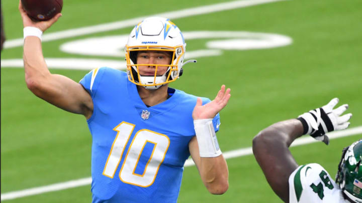 Nov 22, 2020; Inglewood, California, USA; Los Angeles Chargers quarterback Justin Herbert (10) throws the ball against the New York Jets in the second half at SoFi Stadium. Mandatory Credit: Jayne Kamin-Oncea-USA TODAY Sports
