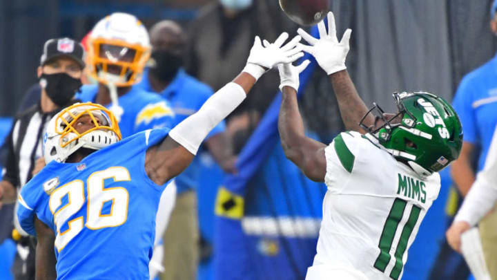 Nov 22, 2020; Inglewood, California, USA; New York Jets wide receiver Denzel Mims (11) catches a pass against Los Angeles Chargers cornerback Casey Hayward (26) in the second half at SoFi Stadium. Mandatory Credit: Jayne Kamin-Oncea-USA TODAY Sports