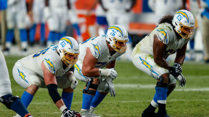 Nov 1, 2020; Denver, Colorado, USA; Los Angeles Chargers center Dan Feeney (66) and offensive guard Forrest Lamp (76) and offensive tackle Sam Tevi (69) in the fourth quarter against the Denver Broncos at Empower Field at Mile High. Mandatory Credit: Isaiah J. Downing-USA TODAY Sports