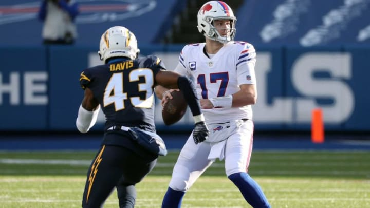 Bills quarterback Josh Allen delivers the ball just ahead of pressure by chargers Michael Davis (43). Jg 112920 Bills 22