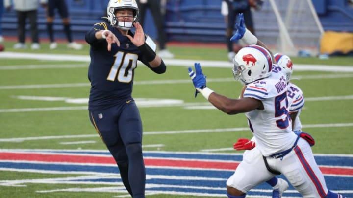 Chargers quarterback Justin Herbert makes an off balance throw as he is pressured by bills Jerry Hughes. Jg 112920 Bills 21