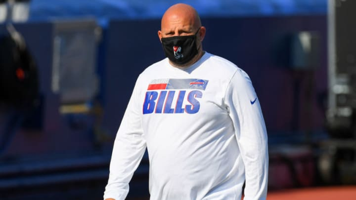 Sep 27, 2020; Orchard Park, New York, USA; Buffalo Bills offensive coordinator Brian Daboll walks the field while wearing a mask prior to the game against the Los Angeles Rams at Bills Stadium. Mandatory Credit: Rich Barnes-USA TODAY Sports