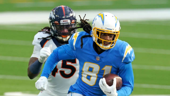 Dec 27, 2020; Inglewood, California, USA; Los Angeles Chargers wide receiver Mike Williams (81) runs with the ball as Denver Broncos inside linebacker A.J. Johnson (45) defends during the first half at SoFi Stadium. Mandatory Credit: Kirby Lee-USA TODAY Sports
